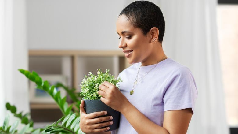 woman tending houseplants