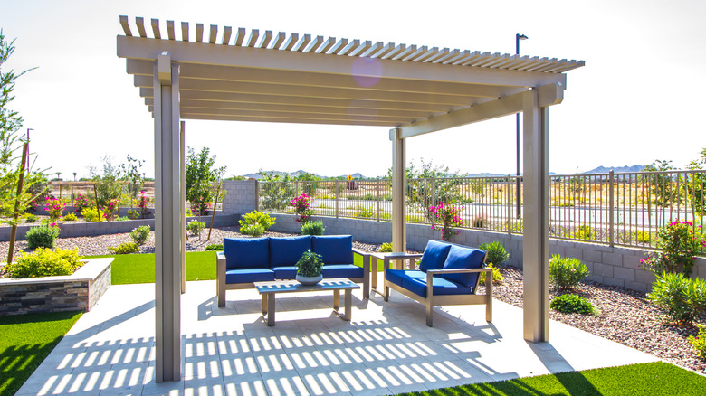 Outdoor pergola with seating area