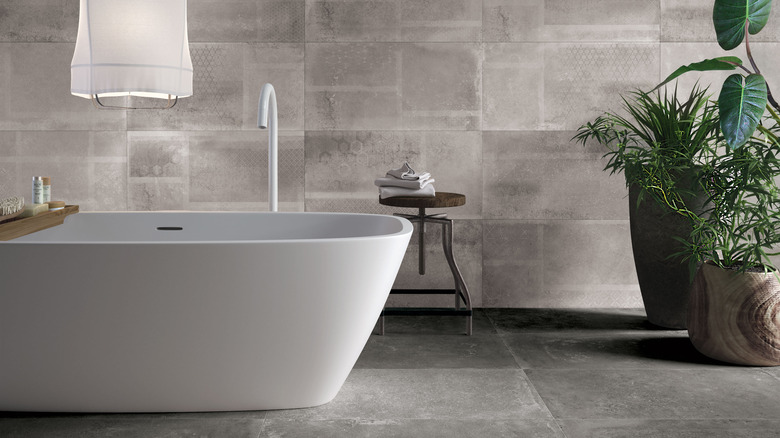 Gray and white bathroom with plant