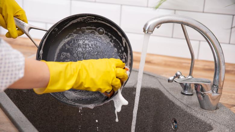 hands washing ceramic pan
