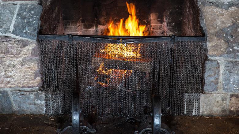 roaring fire in stone fireplace