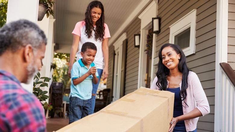 Family bringing furniture home