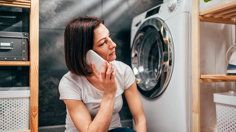 Woman calling for help about a broken washing machine