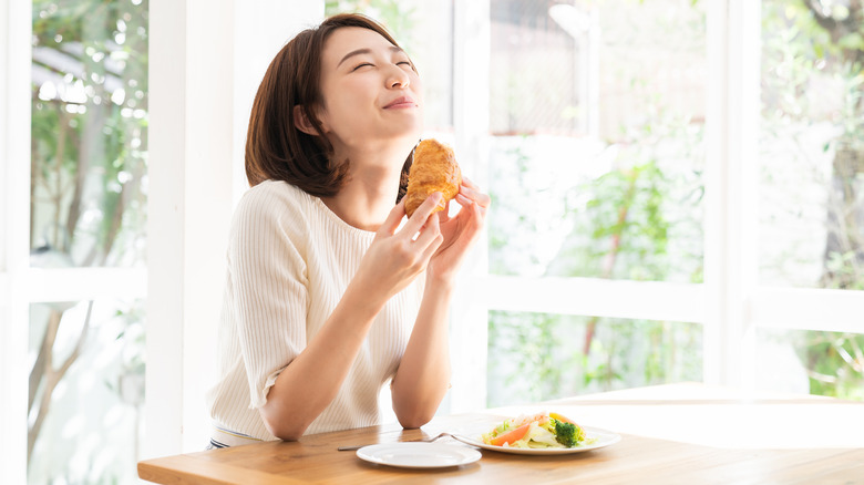 woman enjoying breakfast at home