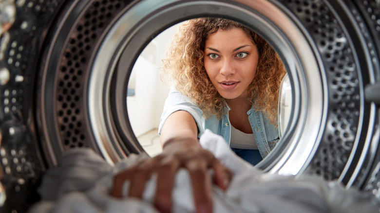 View Looking Out From Inside Washing Machine As Woman Does White Laundry