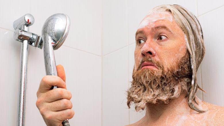 Man looking worried while showering