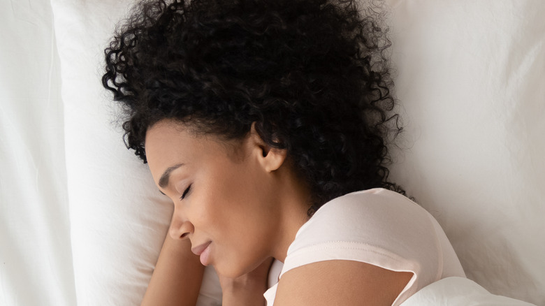 Woman sleeping bed pillows