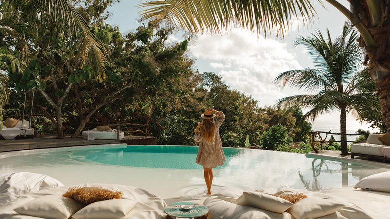 woman swimming pool pillows