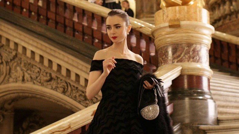 Lily Collins in Emily in Paris on stairs
