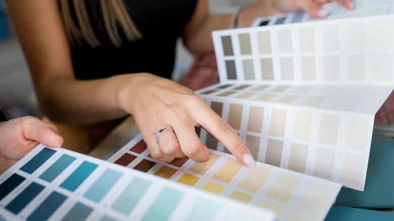 woman choosing paint colors