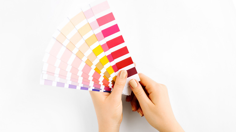 Someone holding paint swatches
