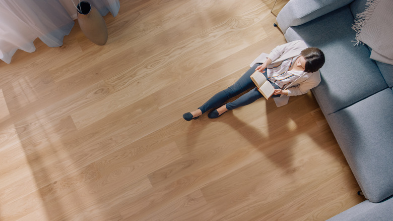 Person in room with wood floors