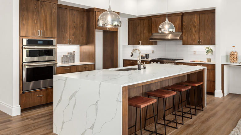 Luxury white and brown kitchen with island