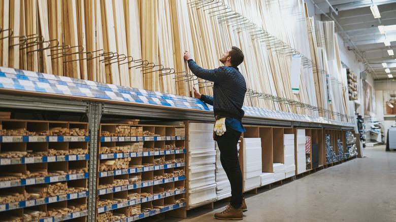 man shopping for lumber