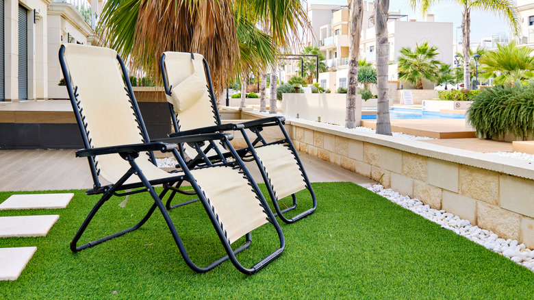lawn chairs on artificial lawn