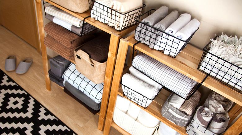 folded towels in wire baskets