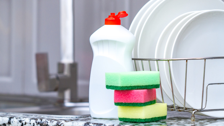 bottle of dish soap sitting by sink