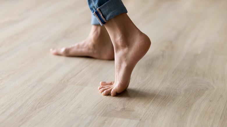 someone walking on wood floors