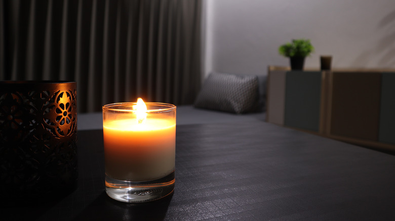 scented candle dark background