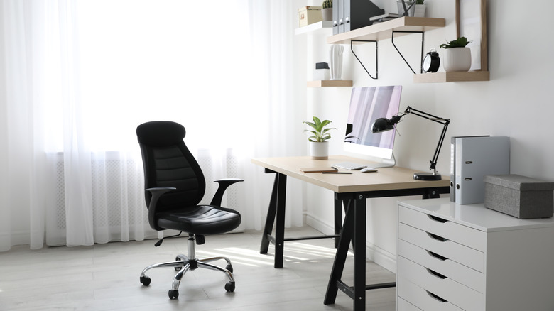 A home office with white walls