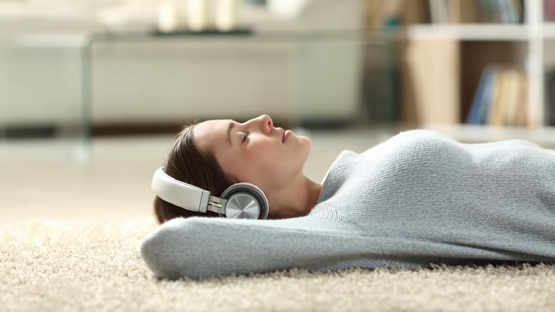 woman laying on carpet