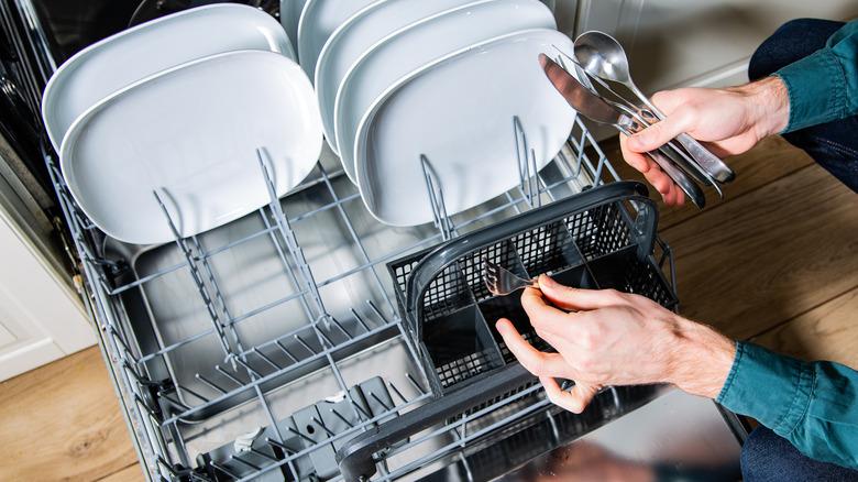 Person loading dishwasher